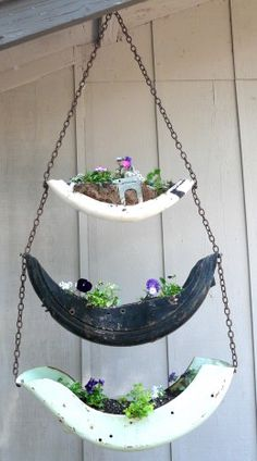 Found material hanging planter: http://sherryhewins.hubpages.com/hub/Rust-is-Beautiful-Seeing-the-Beauty-in-old-Junk-Unique-Yard-Art