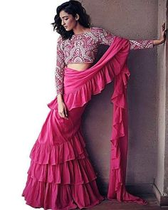 Fantastic New Saree Styles For Your Next Cocktail Party - - Want to try out some New Saree Styles for the next wedding function? Check out amazing ruffles and peplum saree designs that are also available on budget. Drape Sarees, Saree Draping Styles, Saree Styles, Trendy Sarees, Stylish Sarees, Indian Dresses, Indian Outfits, Saris Indios, Woman Clothing