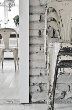 white Tolic chairs - I totally want one..they're looking shabby and old and just PERFECT in my eyes