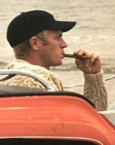 "Steve McQueen behind the wheel of his dune buggy from ""The Thomas Crown Affair."""