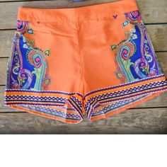 HPGorgeous shorts! NWOT. A must have! These colors are absolutely gorgeous! 100% Polyester. HP by @emory1975. PRICE FIRM Shorts