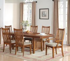 Features Add a casual and traditional look to your dining room. This great set is constructed of poplar solids with oak veneers with a oak finish. It includes