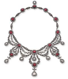 A DIAMOND AND RUBY NECKLACE   Designed as a series of single and rose-cut diamond floral and foliate swags gathered by oval-cut ruby and rose-cut diamond clusters suspending rose and single-cut diamond cluster drops to the backchain of similar motif.