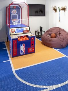 Decorating Ideas for Fun Playrooms and Kids' Bedrooms : If you're going to get an arcade game, why not get a floor to match? Not only are these rubber floor mats colorful and well thought out, they are ideal for a playroom because they are soft and warm on the feet, and they will acoustically buffer the sound of kids bouncing basketballs in the house. From DIYnetwork.com