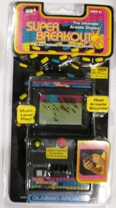 "Classic Arcade Super Breakout Handheld Game by MGA Entertainment. $59.95. Smash row after row of bricks; break through to the other side and watch the wall crumble! This sleek handheld version of the classic arcade game has all the cool graphics and sounds of the original and features 5 levels of play, a bright LCD screen and automatic scoring keep the action in high gear. Comes with auto shutoff. Requires 2 AA batteries (not included). Ages 6 years and up. Imported. 5-1/2Hx4Wx1-1/4D""."