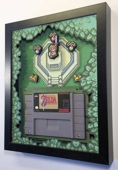 Zelda: A Link to the Past Cartridge Holder Shadow Box Diorama for SNES with optional Replica Cart -Made of layered foam board (not cardstock!) -Solid wooden MDF frame -Best gift of all time for gamers -Ready to hang on your wall or stand on a desk -lightf Retro Videos, Retro Video Games, Space Invaders, Pac Man, The Legend Of Zelda, Shadow Box, Deco Gamer, Video Game Rooms, Geek Decor
