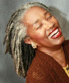 Gray natural hair + gray locks + great smile.. Beautiful