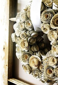 Book pages made into a wreath. Although I hate hate hate destroying books like this, I love the way it looks. Maybe if I bought a really horrible book at a yard sale?