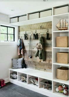 Cubbies with board backing for mud room/ laundry room