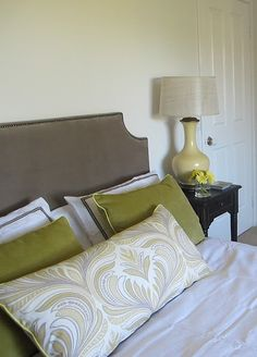 pretty colors- love the piping on the pillows.  via VT Interiors