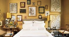 In the master bedroom of Muriel Brandolini's New York City townhouse, the bed is upholstered in 18th-century French fabric and dressed in linens hand-embroidered in Vietnam; lamps made from parts of American printing presses flank the bed. The works on the wall include a painting by Philip Taaffe, a drawing by Van Day Truex, and two 18th-century French gold-embroidered panels; the Bons rug is by Fedora Design.   - ELLEDecor.com