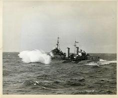 HMS Edinburgh underway in the Atlantic Ocean while escorting USS Wasp, 3 Apr 1942; side 1 of photo