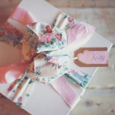 Use strips of fabric, ribbon and DIY name tags to create a beautiful presentation for bridesmaids gifts. Image: Simply Rosie Photography