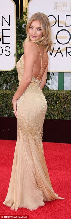 Stunning: The beautiful design had spaghetti straps which criss-crossed at the back and a ...