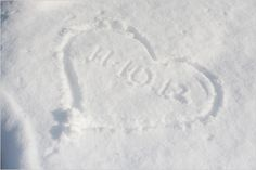 So simple for a winter wedding writing the wedding date in a heart in the snow