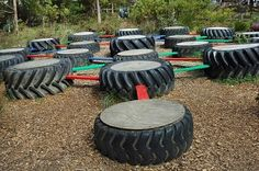 Rubber tire and colour planks which must be crossed in order. From the Enchanted Maze Garden in Australia.