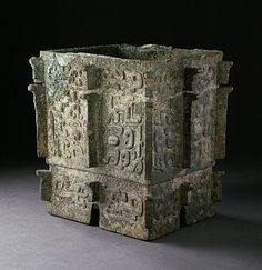 China  Lidless Square Ritual Wine Container (Fangyi) with Masks and Dragons, Late Shang dynasty, late Anyang phase, about 1100-1050 B.C.  Metalwork; bronze, Cast bronze