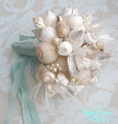 Description This is a full payment for a custom bouquet +bout. This item is made to order. Bouquet is of the Hinewai Bouquet as shown in Our Wedding, Destination Wedding, Dream Wedding, Seaside Wedding, Nautical Wedding, Party Wedding, Floral Wedding, Seashell Bouquet, Seashell Wedding