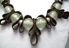 Steal the show with this gorgeous beaded ribbon necklace by AlyxAndrea Design features unique pale green glass beads with white swirls inside