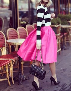 this vibrant pink softly pleated skirt & striped fitted sweater certainly catch the eye (gorgeous stilettos & chanel purse)