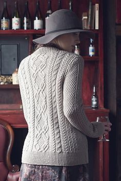 With its combination of cables and cashmere, the Ennis Pullover is an alluring, elegant, and feminine knit. The pullover is worked in pieces and seamed together in the tradition of classic cabled pull-overs. The neckband, picked up and worked in the round, finishes this adventurous and beautiful sweater.