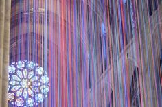 Gorgeous art installation that features 20 miles of ribbon cascading from the Grace Cathedral in San Francisco vaulted ceiling arches.