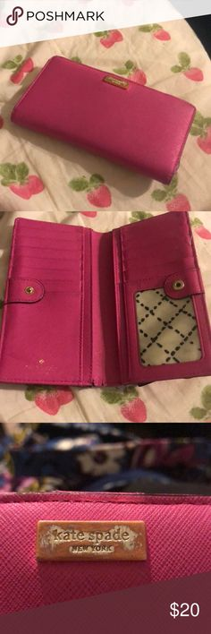 "Kate spade pink wallet Authentic Kate spade wallet in hot pink color.  Classic single snap closure style with 12 card slots, clear ID window, 4 full length slip pockets, and zippered pocket in back.  Wallet is in good used condition. Only flaw I detect is the hardware on front of wallet that contains the brand logo "" Kate spade New York"" - the finish is somewhat rubbed off but logo still readable and it's result of daily wear and use...it's not a fake!  Note: replicas contain incorrect logos…"