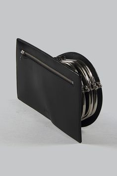 Half Measures Peel Back Clutch - A sculptural flat clutch with three kiss-lock closure side compartments and single back zip compartment, constructed from semi-gloss vegetable tanned leather. Vegetable Tanned Leather, Sculpture, Kiss, Closure, Flat, Bass, A Kiss, Sculpting, Sculptures