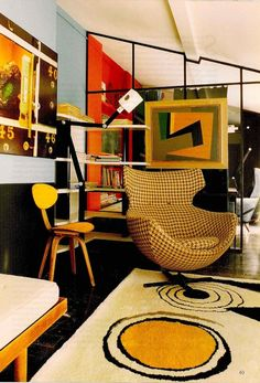 This is a particularly swanky interior-I especially love the geometric wall divider.