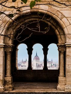 "Budapest - Fisherman's Bastion  ""An archway in the Fisherman's Bastion provides a great view of the Hungarian Parliament Building in Budapest."""