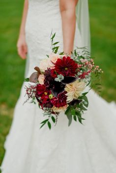 Lush fall bouquet with Californian dahlias and pepperberry