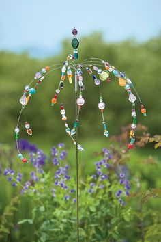 A great idea for using all the glass beads I've made that are just sitting around!  Dancing Garden Jewels Sculpture | Buy from Gardener's Supply