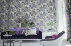 Alexandria Amethyst (P623/03) - Designers Guild Wallpapers - A large floral design with various flowers including poppies, roses, clematis and hydrangea's. Shown here in white, purple, blue and green on a grey background. Please request a sample for a true colour match. Paste the wall product. Pattern repeat 72cm.