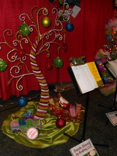 Dr. Seuss looking Christmas tree - love this for the kids table as a center piece.