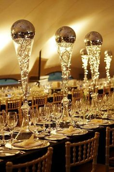 Get rid of the disco ball and I'm in Opulent gold-themed party. Centerpieces adorning the tables are tall clear glass flutes filled with mini lights and topped with small gold disco balls. Decoration Table, Table Centerpieces, Wedding Centerpieces, Wedding Decorations, Black And Gold Centerpieces, Music Centerpieces, Non Floral Centerpieces, Disco Party Decorations, Floral Arrangements