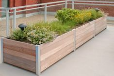 large multi section wooden garden planter