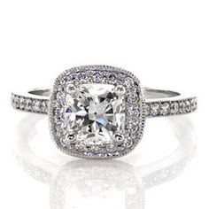 Cushion Amante - This ring style is a fashion-forward design with its cushion halo and center stone. micro pavé diamonds accentuate the 1.0 carat cushion cut diamond in the halo and along the band. The raised shoulders showcase the halo as well as allowing a great fit for a diamond wedding band.