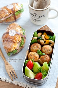 Croissant with bacon and eggs, melon, tomatoes, and potato balls, and salad of steamed veggies with cashew nuts.