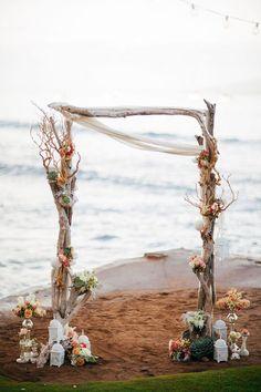 Flower adorned driftwood beach wedding arbor / http://www.deerpearlflowers.com/driftwood-wedding-decor-ideas/2/