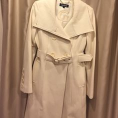 Ivory Guess Coat! I got this beautiful Ivory Coat as a gift.. I loved it so much i yanked the tag off before i even tried it on.. And it was too big  In excellent condition. Never been worn. New without tags. Guess Jackets & Coats