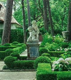 Co Co's Collection: This formal garden elevates a small space # formal  # garden… #BoxwoodLandscape