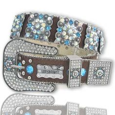 Brown Belt With Turquoise And Clear Rhinestone    ALL RHINESTONES AND STUDS ON BELT STRAP ARE RIVETED COVERED ON THE BACK.    DOUBLE SCREW ON BELT BUCKLE TAB MAKES IT CONVENIENT TO CUT AND SIZE UP THE BELT IF NEEDED.    3 PIECE RHINESTONE BUCKLE SET.