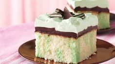 Pretty streaks of green peek out from slices of white cake topped with hot fudge sauce and creamy whipped topping.