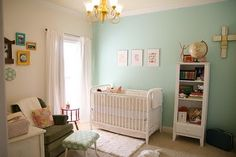 one turquoise wall, other walls with different colored frames