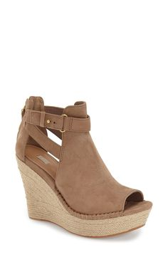Free shipping and returns on UGG® 'Jolina' Open-Toe Wedge (Women) at Fashiondoxy.com. A braided ropey wedge lifts a trend-right open-toe shaped from buttery-soft nubuck leather and fashioned with sultry cutout sides