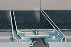 EXPANSION JOINT COVERS Construction Specialties, Inc.;  silver certified; Building materials , Expansion Joint Covers