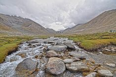 Photo of River Filled With Bolder Rocks  Free Stock Photo