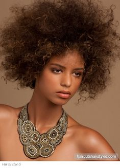 This long Afro hairstyle is a real statement hair design you can embrace.Tease your locks to add extra volume to your locks.