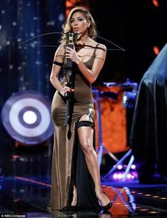 Sizzling: Nicole Schersingergot to grips with a crossbow for a new episode of I Can Do Th...