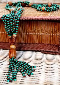 """IFA""  ILEKE Necklace Product #35(a)_3304  Description: Green and Brown Glass Seed Beads, with Designer Wooden Beads,  4 Strands,  22"" Long  (2013)  https://www.etsy.com/shop/SosihweFashionsGifts http://thesisterhoodpsychology.weebly.com/jewelry.html"
